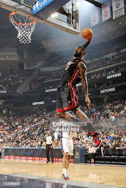 LeBron James of the Miami Heat goes to the basket for a dunk during the game against the New Jersey Nets on April 16 2012 at the Prudential Center in...