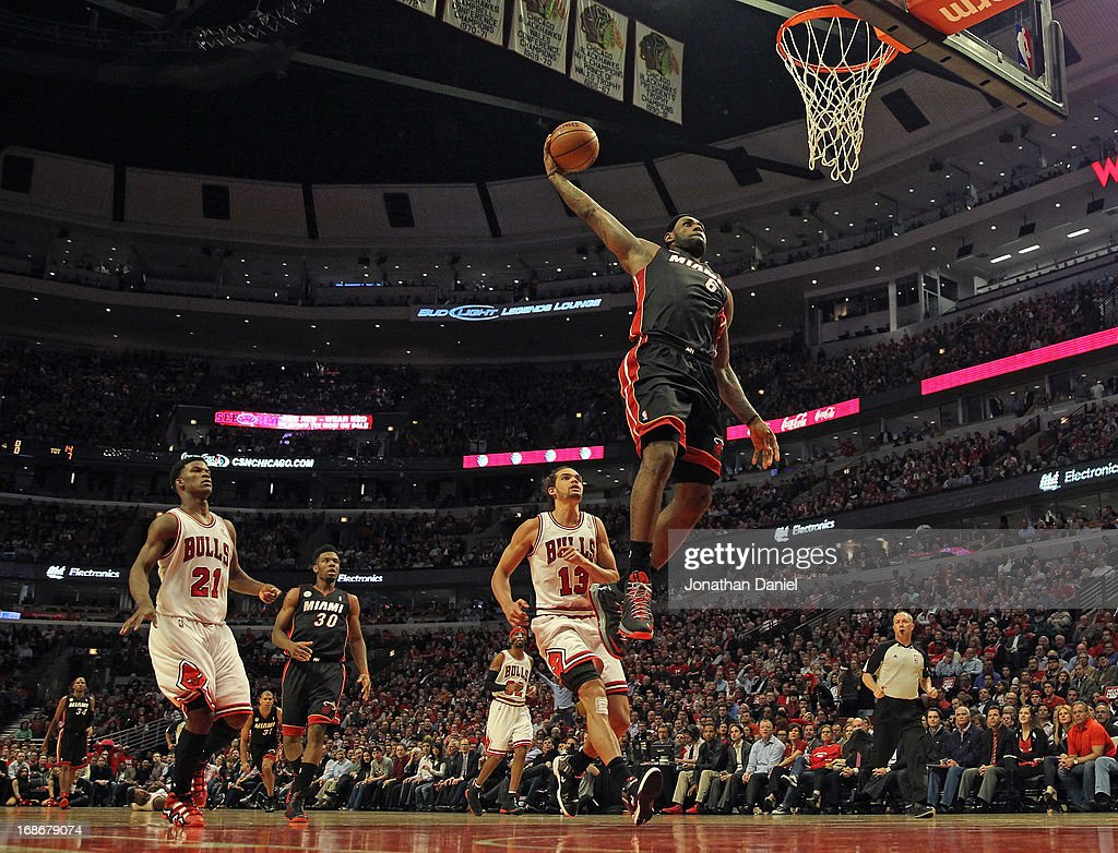 LeBron James #6 of the Miami Heat goes up for a dunk past Jimmy Butler #21 and Joakim Noah #13 of the Chicago Bulls in Game Four of the Eastern Conference Semifinals during the 2013 NBA Playoffs at the United Center on May 13, 2013 in Chicago, Illinois.