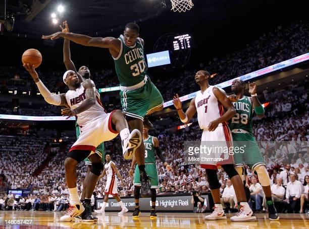 LeBron James of the Miami Heat goes up for a shot against Brandon Bass of the Boston Celtics in the second half in Game Seven of the Eastern...