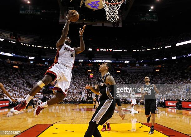 LeBron James of the Miami Heat goes up for a shot against Danny Green of the San Antonio Spurs in the fourth quarter during Game Two of the 2013 NBA...