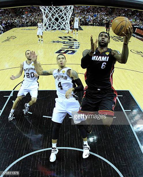 LeBron James of the Miami Heat goes up for a shot against Danny Green of the San Antonio Spurs in the first half during Game Four of the 2013 NBA...