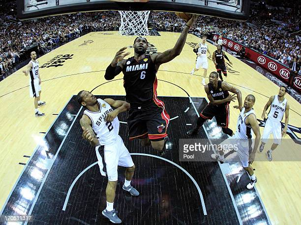 LeBron James of the Miami Heat goes up for a shot against Kawhi Leonard of the San Antonio Spurs in the first half during Game Four of the 2013 NBA...