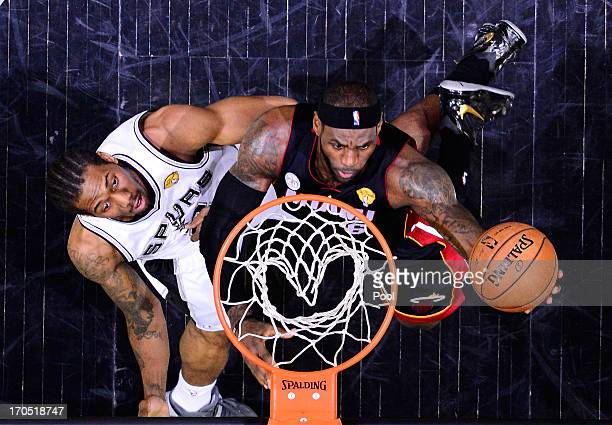 LeBron James of the Miami Heat goes up for a shot against Kawhi Leonard of the San Antonio Spurs during Game Four of the 2013 NBA Finals at the ATT...