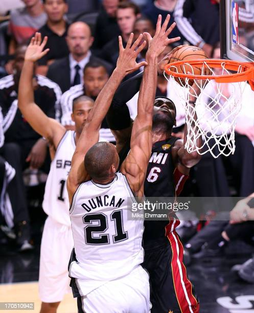 LeBron James of the Miami Heat goes up for a shot against Tim Duncan of the San Antonio Spurs in the second quarter during Game Four of the 2013 NBA...