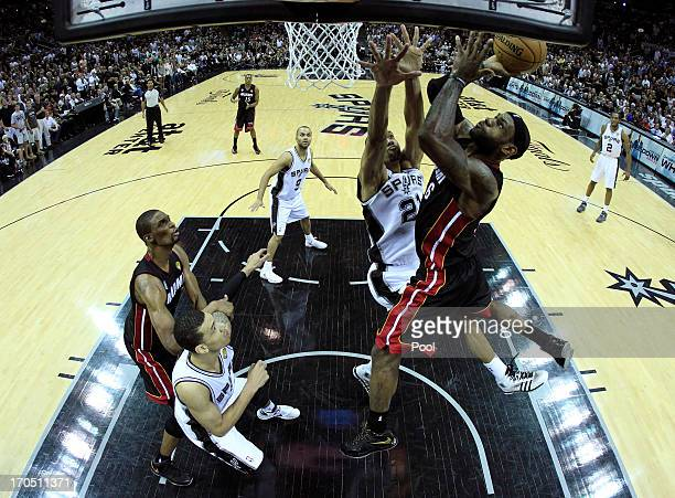 LeBron James of the Miami Heat goes up for a shot against Tim Duncan of the San Antonio Spurs in the first half during Game Four of the 2013 NBA...