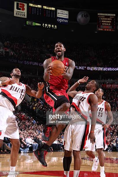 LeBron James of the Miami Heat goes up for a shot against Wesley Matthews and LaMarcus Aldridge of the Portland Trail Blazers during a game on...