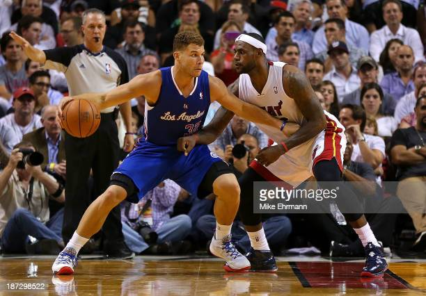 LeBron James of the Miami Heat guards Blake Griffin of the Los Angeles Clippers during a game at AmericanAirlines Arena on November 7 2013 in Miami...