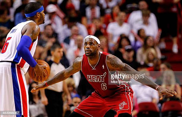 LeBron James of the Miami Heat guards Josh Smith of the Detroit Pistons during a game at American Airlines Arena on December 3 2013 in Miami Florida...
