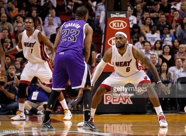 LeBron James of the Miami Heat guards Marcus Thornton of the Sacramento Kings during a game at American Airlines Arena on February 21 2012 in Miami...