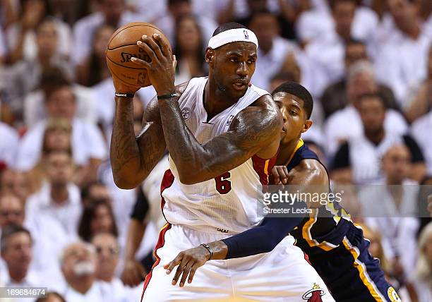 LeBron James of the Miami Heat handles the ball against Paul George of the Indiana Pacers in the third quarter during Game Five of the Eastern...