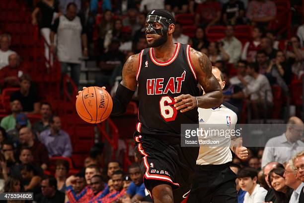 LeBron James of the Miami Heat handles the ball during a game against the New York Knicks at the American Airlines Arena in Miami Florida on Feb 27...