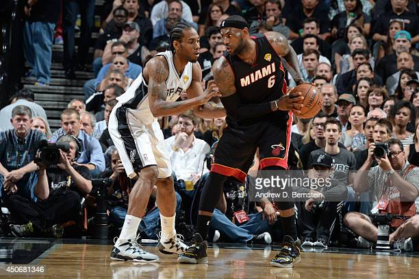 LeBron James of the Miami Heat handles the basketball against Kawhi Leonard of the San Antonio Spurs during Game Five of the 2014 NBA Finals between...