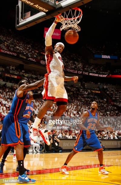 LeBron James of the Miami Heat hangs from the rim after a dunk against the New York Knicks in Game Five of the Eastern Conference Quarterfinals...