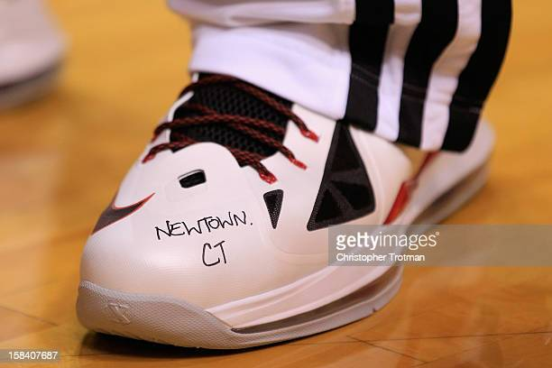 LeBron James of the Miami Heat honored the victims of the Newtown school shooting with an inscription on his shoe during the game against the...