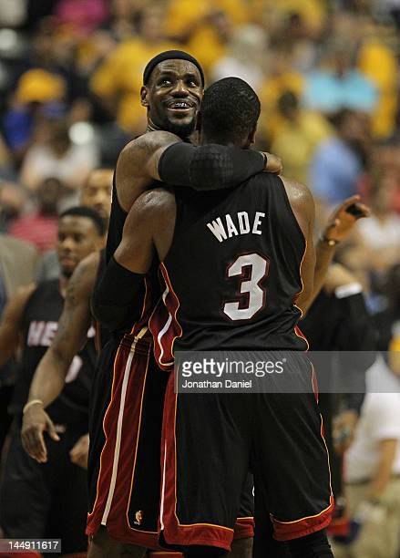LeBron James of the Miami Heat hugs teammate Dwyane Wade near the end of a win over the Indiana Pacers in Game Four of the Eastern Conference...