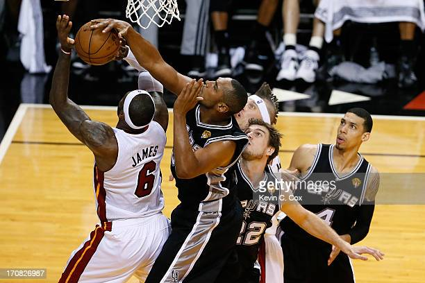 LeBron James of the Miami Heat is blocked by Boris Diaw of the San Antonio Spurs to end the first quarter during Game Six of the 2013 NBA Finals at...