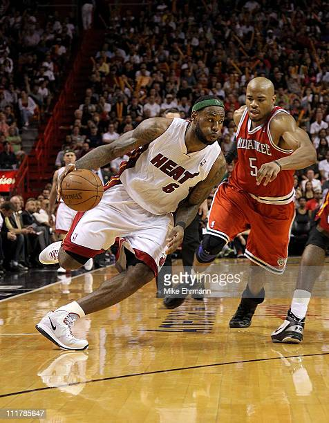 Lebron James of the Miami Heat is guarded by by Corey Maggette of the Milwaukee Bucks during a game at American Airlines Arena on April 6 2011 in...