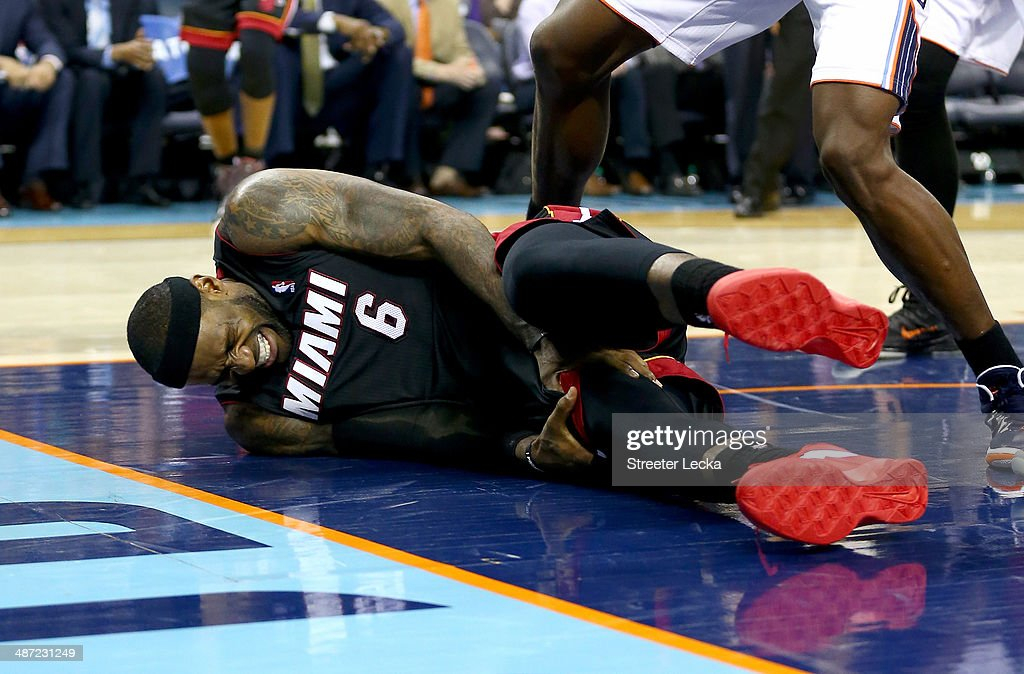 LeBron James #6 of the Miami Heat is injured against the Charlotte Bobcats in Game Four of the Eastern Conference Quarterfinals during the 2014 NBA Playoffs at Time Warner Cable Arena on April 28, 2014 in Charlotte, North Carolina.