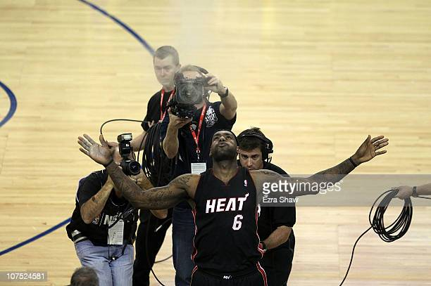 Lebron James of the Miami Heat is surrounded by media as he throws powder in the air before their game against the Golden State Warriors at Oracle...