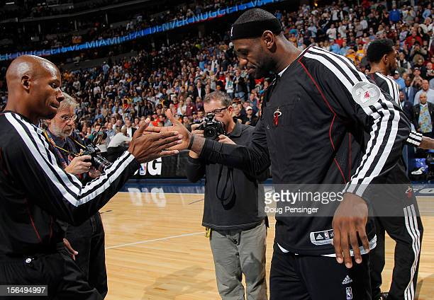 LeBron James of the Miami Heat is welcomed to the court by Ray Allen of the Miami Heat to face the Denver Nuggets at the Pepsi Center on November 15...