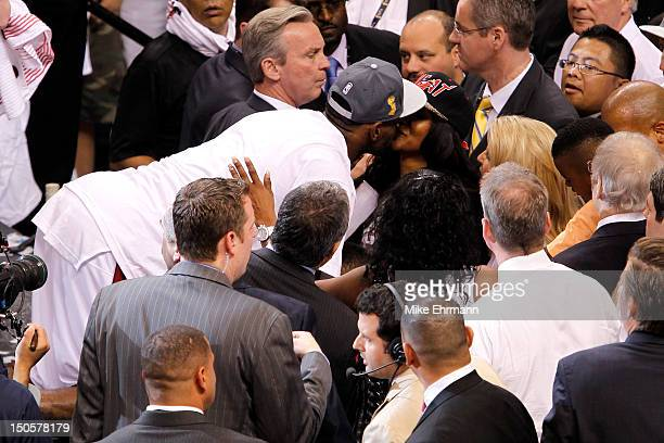 LeBron James of the Miami Heat kisses his wife Savannah Brinson after they Heat won 121106 against the Oklahoma City Thunder in Game Five of the 2012...