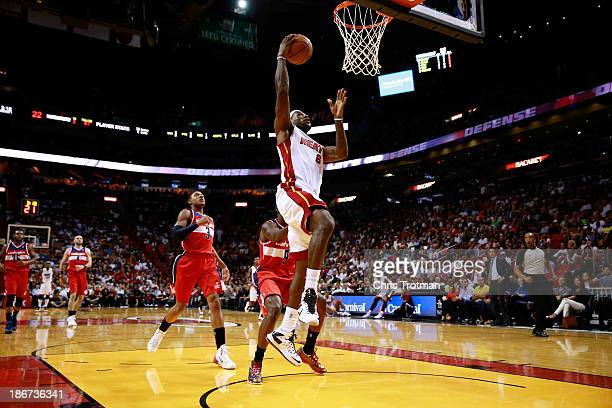 LeBron James of the Miami Heat lays the ball up in front of Bradley Beal of the Washington Wizards and Martell Webster of the Washington Wizards at...