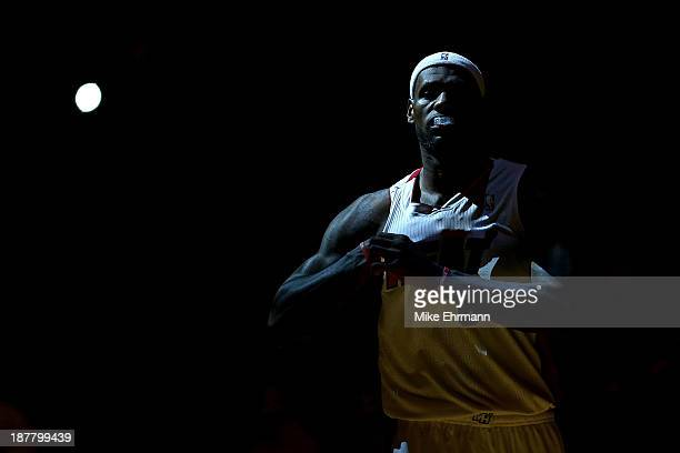 LeBron James of the Miami Heat looks on during a game against the Milwaukee Bucks at AmericanAirlines Arena on November 12 2013 in Miami Florida NOTE...
