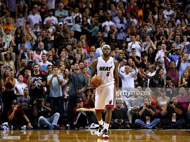 LeBron James of the Miami Heat looks on during a game against the Toronto Raptors at AmericanAirlines Arena on January 5 2014 in Miami Florida NOTE...