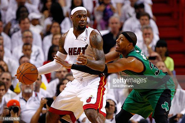 LeBron James of the Miami Heat looks to move the ball in the post in the first quarter against Paul Pierce of the Boston Celtics in Game One of the...