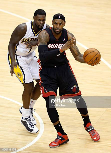 LeBron James of the Miami Heat looks to pass as Lance Stephenson of the Indiana Pacers defends during Game Five of the Eastern Conference Finals of...