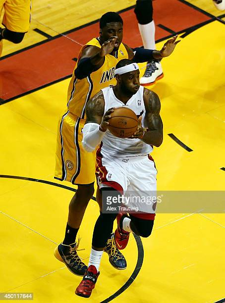LeBron James of the Miami Heat looks to pass as Roy Hibbert of the Indiana Pacers defends during Game Three of the Eastern Conference Finals of the...