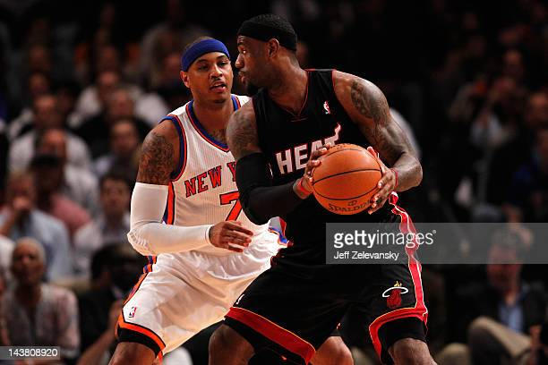 LeBron James of the Miami Heat looks to pass in the first quarter against Carmelo Anthony of the New York Knicks in Game Three of the Eastern...