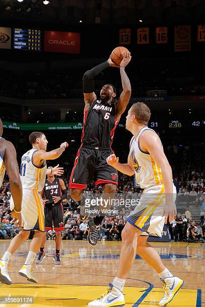 LeBron James of the Miami Heat makes a shot, passing the 20,000 point career milestone, during a game against the Golden State Warriors on January...