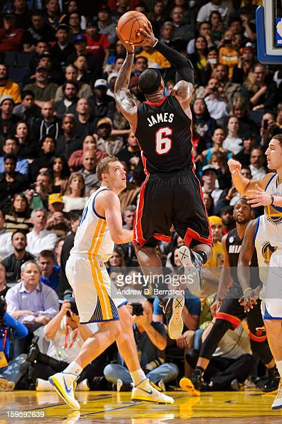LeBron James of the Miami Heat makes a shot, passing the 20,000 point career milestone, against the Golden State Warriors on January 16, 2013 at...