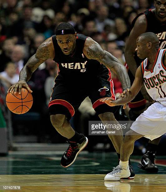 LeBron James of the Miami Heat moves past Earl Boykins of the Milwaukee Bucks at the Bradley Center on December 6 2010 in Milwaukee Wisconsin The...