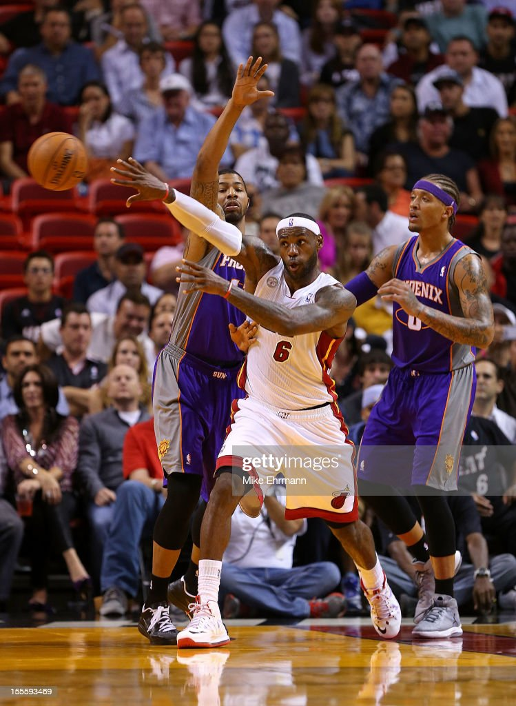 LeBron James #6 of the Miami Heat passes away from Shannon Brown #26 and Michael Beasley #0 of the Phoenix Suns during a game at AmericanAirlines Arena on November 5, 2012 in Miami, Florida.