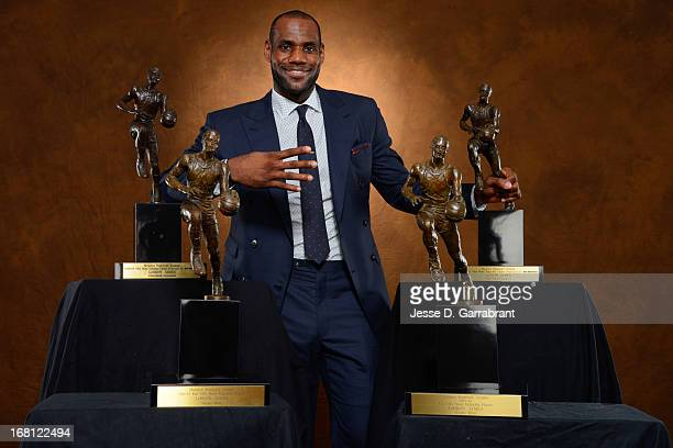 LeBron James of the Miami Heat poses with his collection of Maurice Podoloff Trophies after being named the 2012-2013 Kia NBA Most Valuable Player of...