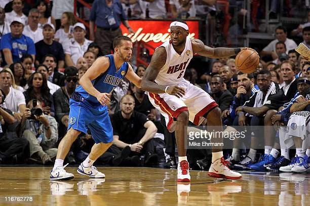 LeBron James of the Miami Heat posts up against Jose Juan Barea of the Dallas Mavericks in Game Six of the 2011 NBA Finals at American Airlines Arena...