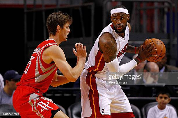 LeBron James of the Miami Heat posts up Chandler Parsons of the Houston Rockets during a game at American Airlines Arena on April 22 2012 in Miami...