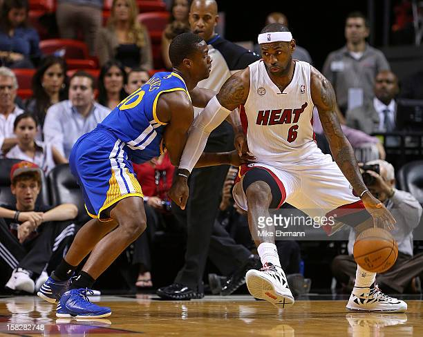 LeBron James of the Miami Heat posts up Kent Bazemore of the Golden State Warriors during a game at American Airlines Arena on December 12 2012 in...