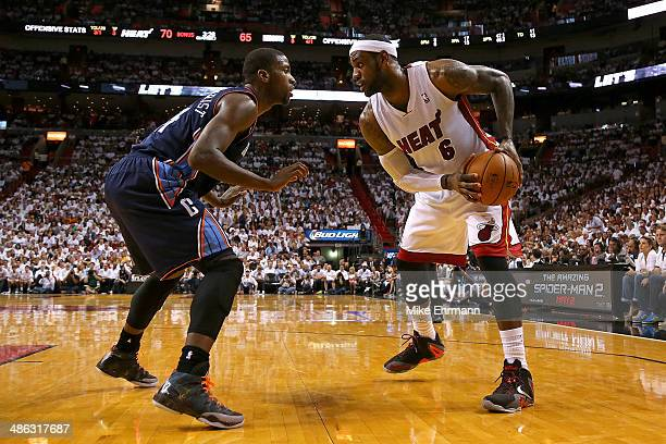 LeBron James of the Miami Heat posts up Michael KiddGilchrist of the Charlotte Bobcats during Game Two of the Eastern Conference Quarterfinals of the...
