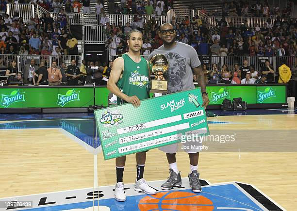 LeBron James of the Miami Heat presents a trophy and check to the winner during the Sprite Slam Dunk Showdown on center court at Jam Session during...