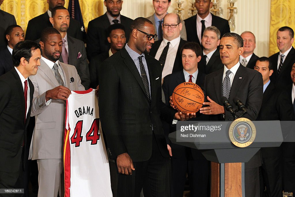 LeBron James #6 of the Miami Heat presents an autographed basketball to President Barack Obama during a visit by the Miami Heat to the White House to commemorate the 2012 NBA Champions on January 28, 2013 in Washington, DC.