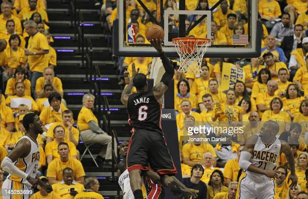 LeBron James of the Miami Heat puts up a shot as Roy Hibbert and David West of the Indiana Pacers watch in Game Six of the Eastern Conference...