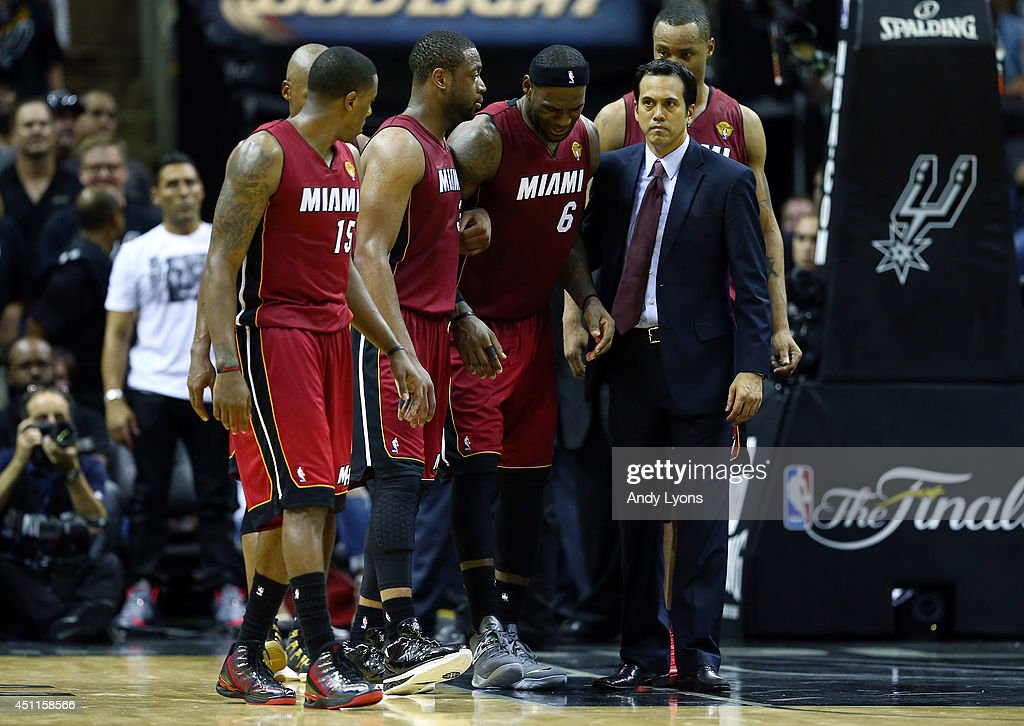 89fe2ee7d81 LeBron James of the Miami Heat reacts after cramping up against the ...