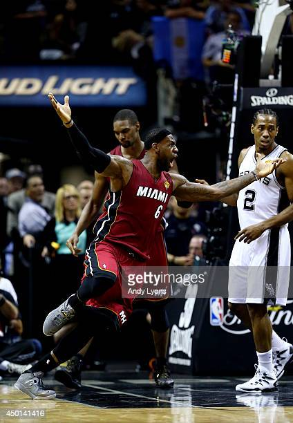 LeBron James of the Miami Heat reacts after getting called for goaltending against the San Antonio Spurs during Game One of the 2014 NBA Finals at...