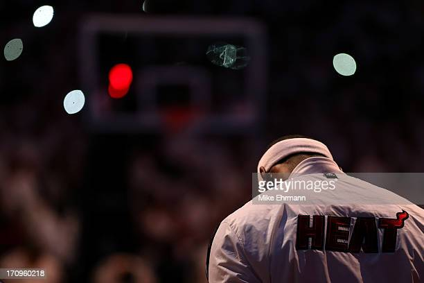 LeBron James of the Miami Heat reacts during the national anthem before taking on the San Antonio Spurs in Game Seven of the 2013 NBA Finals at...