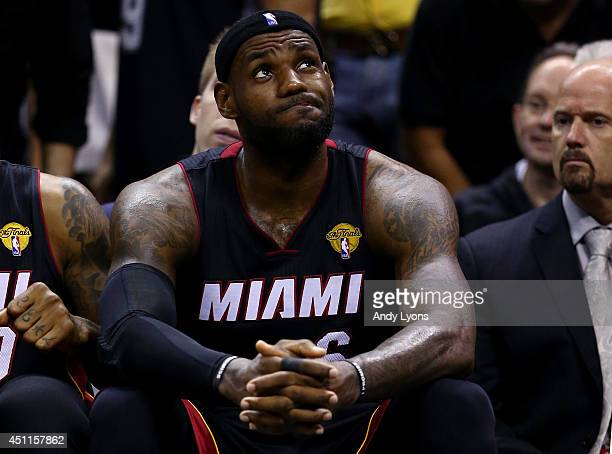 LeBron James of the Miami Heat reacts on the bench against the San Antonio Spurs during Game Five of the 2014 NBA Finals at the ATT Center on June 15...