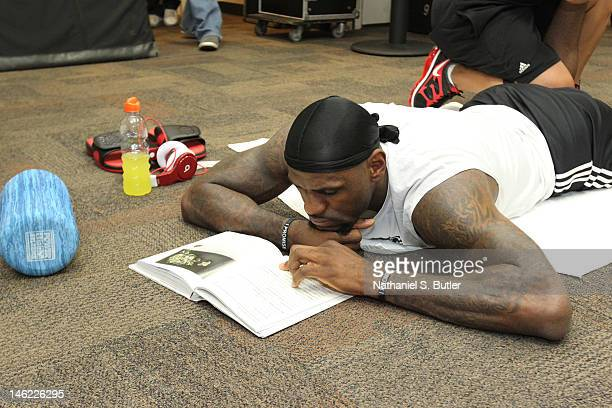 LeBron James of the Miami Heat reads a book in the locker room prior to Game One of the 2012 NBA Finals against Oklahoma City Thunder at the...