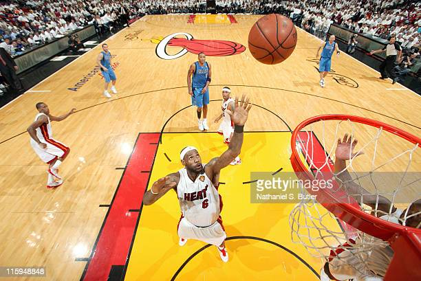 LeBron James of the Miami Heat rebounds against the Dallas Mavericks during Game Six of the 2011 NBA Finals on June 12 2011 at the American Airlines...